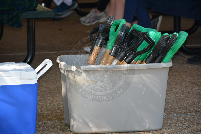 smaller shovels in a plastic bin